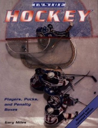 Inside Hockey Players Pucks and Penalty Boxes