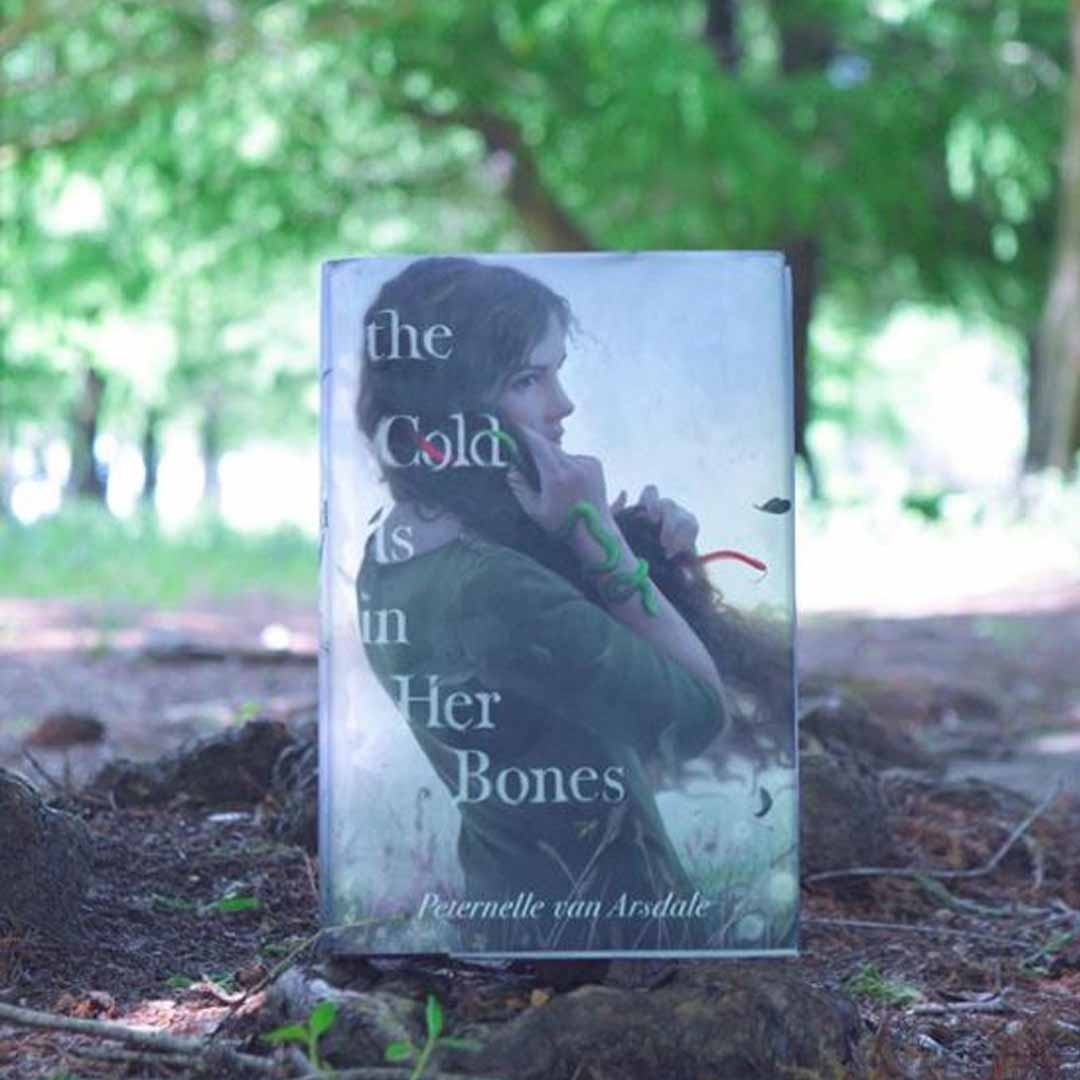 The Cold is in Her Bones Peternelle van Arsdale Book Cover